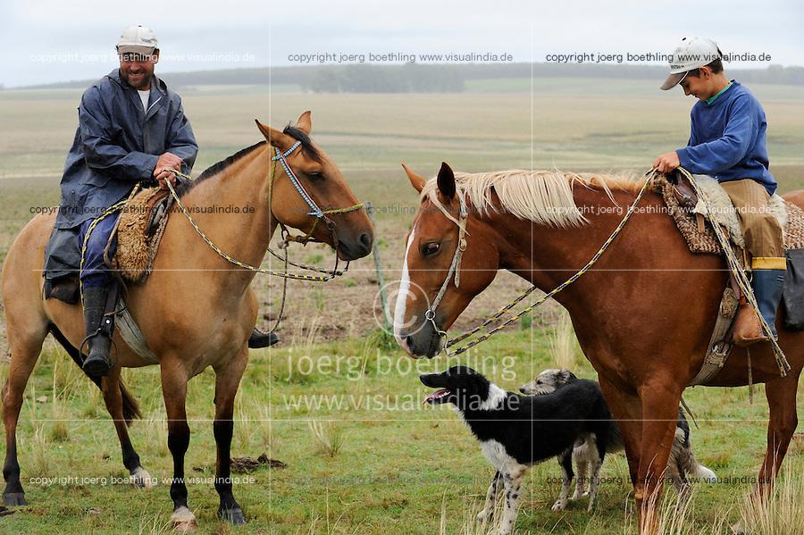URUGUAY , Treinta y Tres, cattle farm , head man with son on horse / Rinderfarm, Farmverwalter und Sohn auf Pferden