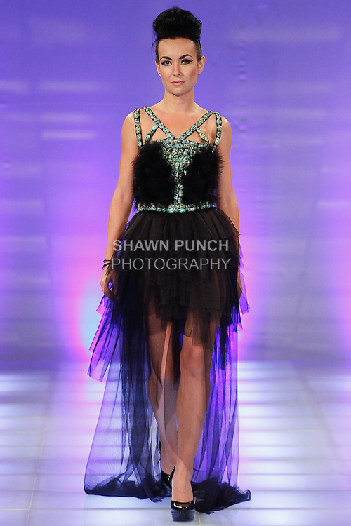Model walks runway in an outfit from the Akylbek Tolomushov collection, during Couture Fashion Week in New York, September 8, 2013.