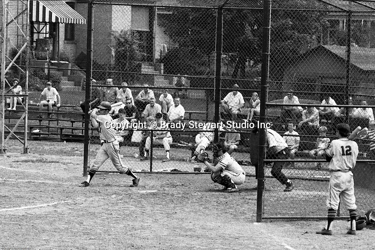 Ford City PA:  Bethel Park vs Arnold to advance to the state American Legion Playoffs.  Paul Hauck swinging and hitting during the game.  Bob Purkey pitched a shut out (1-0) and the team advanced to the state playoffs in Allentown PA. Others in the photo; Lee Patch, Bob Colligan, and Patrick Stewart