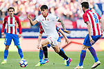 Carlos Joaquin Correa of Sevilla FC is challenged by Atletico de Madrid's players during their La Liga match between Atletico de Madrid and Sevilla FC at the Estadio Vicente Calderon on 19 March 2017 in Madrid, Spain. Photo by Diego Gonzalez Souto / Power Sport Images