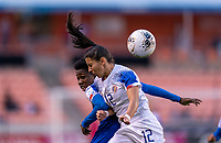 HOUSTON, TX - JANUARY 31: Mikerline Saint Felix #17 of Haiti and Lixy Rodriguez #12 of Costa Rica go up for a header during a game between Haiti and Costa Rica at BBVA Stadium on January 31, 2020 in Houston, Texas.