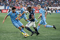 FOXBOROUGH, MA - SEPTEMBER 29: Eric Miller #5 of New York City FC comes in to tackle Cristian Penilla #70 of New England Revolution during a game between New York City FC and New England Revolution at Gillettes Stadium on September 29, 2019 in Foxborough, Massachusetts.