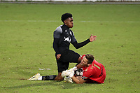 RICHMOND, VA - SEPTEMBER 30: Serge Ngoma #81 of New York Red Bulls II and Alex Tambakis #1 of North Carolina FC collide while challenging for the ball during a game between North Carolina FC and New York Red Bulls II at City Stadium on September 30, 2020 in Richmond, Virginia.