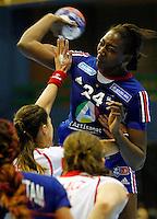 SERBIA, Novi Sad: France's Mariama Signate (R) vies with Poland's Karolina Kudlacz (L) during the Women's Handball World Championship 2013 quarter final match between Poland vs France on December 18, 2013 in Novi Sad.  AFP PHOTO / PEDJA MILOSAVLJEVIC