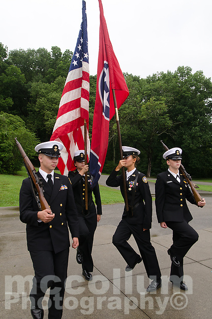 """Michael McCollum<br /> 8/2/18<br /> The Bearden High School Cadets at the reveal ceremony where it was announced to 13 year old Ryan Overman of west Knoxville that The Wish Connection is granting Ryan's wish to go to Washington DC and visit the White House at Carl Cowan Park, 10058 S Northshore Dr, Knoxville, TN, Thursday, August 2, 2018 at 5:45pm. Approximately 50-60 people attended, including the Overman family, friends, and AT&T Employees. The Bearden High School Cadets also attended and lead the pledge of allegiance.<br /> The AT&T Wish Connection is going to send Ryan, his family, and his service dog to Washington DC and while they are gone, the group of volunteers will be doing a makeover on his bedroom and turn it into the """"Oval Office"""" at the White House.<br /> Ryan was born two weeks prematurely on May 13, 2005. During the pregnancy he was classified as high risk due to a measured lack of growth and, after a brief stay in the hospital, he came home weighing only 4 lbs 5 oz. His development was much slower compared to his peers, such as not learning to walk until he was well over a year old, and he was much smaller. The Overman family worked with Tennessee Early Intervention Services (TEIS) when Ryan was about one year old and with their help they were able to get Ryan enrolled through TEIS to receive Occupational, Physical, and Speech Therapy. When Ryan turned three he transitioned from TEIS to the Knox County Early Intervention Program and began attending a special school to continue his therapies until he was old enough to enroll at Cedar Bluff Elementary and now is at Cedar Bluff Middle School. In 2016, Ryan was diagnosed to have retinitis pigmentosa, a degenerative disease of the retinas that under the best of circumstances causes severe tunnel vision, but more commonly results in complete blindness.<br /> Despite the physical difficulties that Ryan has had to endure over the last thirteen years, he continually brightens the lives of those around him. I"""