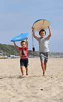 BNPS.co.uk (01202 558833)<br /> Pic: BNPS<br /> <br /> Pictured: Surfs up - Siblings, Jasper, 10 and Lucas Reynaert, 7 enjoy the weather<br /> <br /> Weather input - Warm weather in Bournemouth<br /> <br /> People made the most of the late September sun at Bournemouth beach in Dorset today (Sunday).