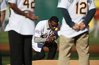 OAKLAND, CA - JULY 19:  Rickey Henderson #24 of the 1989 Oakland A's celebrates their World Series championship 25 years ago, before a game against the Baltimore Orioles at O.co Coliseum on July 19, 2014 in Oakland, California. Henderson is carrying a rose that he will lay down at the pitcher's mound in remembrance of Bob Welch, who died June 9. Photo by Brad Mangin