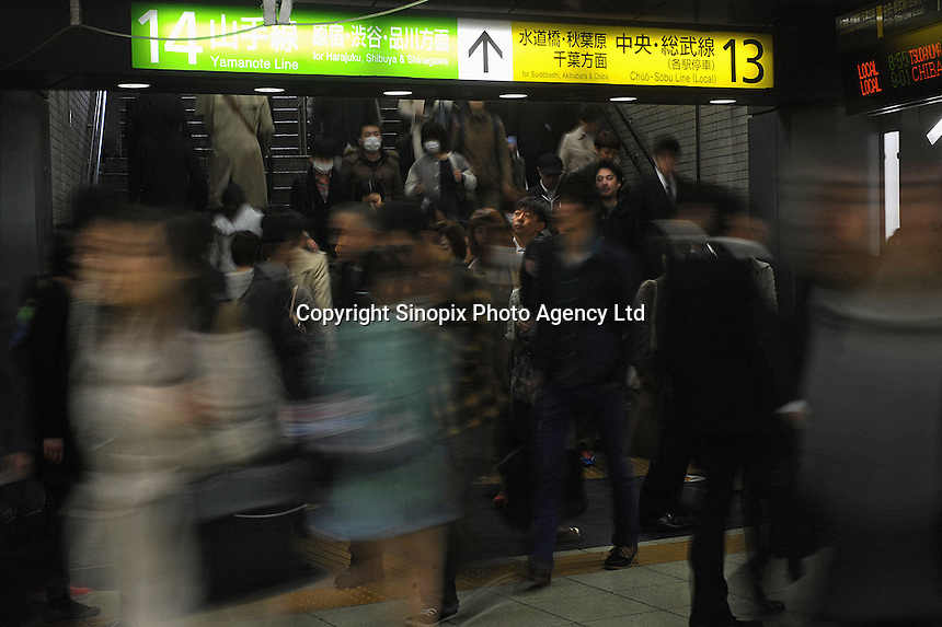 Businessmen rush from a platform into an underground passag in Shinjuku Station, Tokyo, Japan.  With up to 4 million passengers passing through it every day, Shinjuku station, Tokyo, Japan, is the busiest train station in the world. The station was used by an average of 3.64 million people per day.  That's 1.3 billion a year.  Or a fifth of humanity. Shinjuku has 36 platforms, and connects 12 different subway and railway lines.  Morning rush hour is pandemonium with all trains 200% full. <br /> <br /> Photo by Richard jones / sinopix