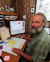 George Zens works on the Sustainable Times from his home office in Middleton on Saturday