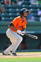Left fielder Shawon Dunston Jr. (15) of the Augusta GreenJackets bats in a game against the Greenville Drive on Sunday, June 12, 2016, at Fluor Field at the West End in Greenville, South Carolina. Greenville won, 11-8. (Tom Priddy/Four Seam Images)