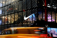 NEW YORK, NEW YORK - FEBRUARY 22: A Taxi crosses in front of the Nike store, on February 22, 2021 in New York. NIKE, Inc. (NYSE:NKE) will trade ex-dividend in the next days , being NIKE's earnings almost flat over the past five years. (Photo by John Smith/VIEWpress)