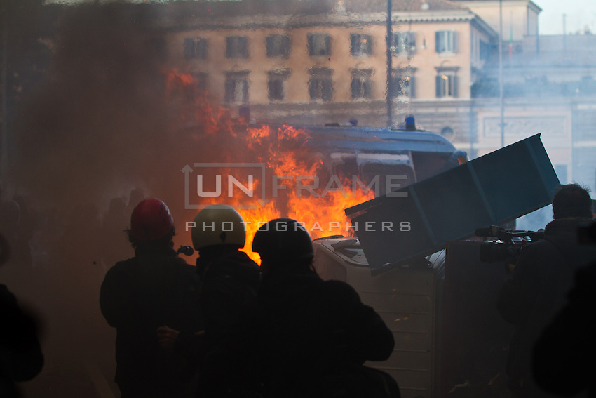 Press photographers reporting during riots in Rome after Senate and Lower House vote of confidence that resulted in a razor-thin victory for Berlusconi to continue his mandate. Dec. 14, 2010 (Photo by Riccardo Budini / UnFrame)