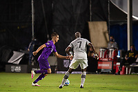 LAKE BUENA VISTA, FL - JULY 25: Joao Moutinho #4 of Orlando City SC dribbles the ball during a game between Montreal Impact and Orlando City SC at ESPN Wide World of Sports on July 25, 2020 in Lake Buena Vista, Florida.