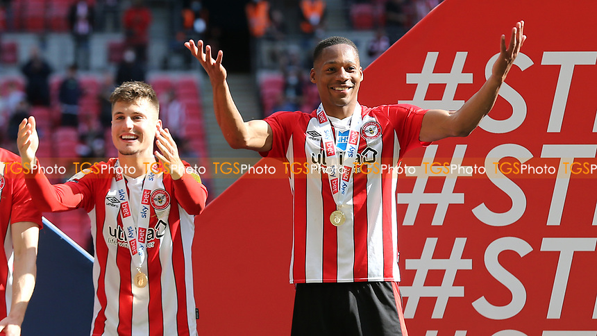 Ethan Pinnock of Brentford leads the celebrations after winning the Championship Trophy along with Sergi Canos during Brentford vs Swansea City, Sky Bet EFL Championship Play-Off Final Football at Wembley Stadium on 29th May 2021