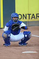 Wladimir Chalo (33) of the Rancho Cucamonga Quakes catches in the bullpen before a game against against the Modesto Nuts at LoanMart Field on May 12, 2021 in Rancho Cucamonga, California. (Larry Goren/Four Seam Images)