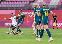 KASHIMA, JAPAN - JULY 27: Crystal Dunn #2 of the USWNT defends Kyah Simon #17 of Australia during a game between Australia and USWNT at Ibaraki Kashima Stadium on July 27, 2021 in Kashima, Japan.