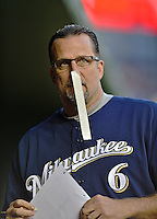 21 September 2012: Milwaukee Brewers third base coach Ed Sedar clowns around while posting the game roster sheet in the dugout prior to a game against the Washington Nationals at Nationals Park in Washington, DC. The Brewers rallied in the 9th inning to defeat the Nationals 4-2 in the first game of their 4-game series. Mandatory Credit: Ed Wolfstein Photo