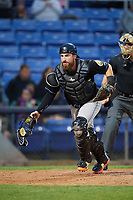Akron RubberDucks catcher Eric Haase (13) retrieves a wild pitch during a game against the Binghamton Rumble Ponies on May 12, 2017 at NYSEG Stadium in Binghamton, New York.  Akron defeated Binghamton 5-1.  (Mike Janes/Four Seam Images)