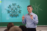 Chair and Professor of Mathematics Dr. Mark Fitch explains the math behind radial engines during his Art of Math course (MATH A115) in UAA's Social Sciences Building.