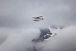 Floatplane in cloud. Prince William Sound. Alaska. U.S.A.