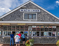 Mac's on the Pier offers fresh seafood at Wellfleet Harbor, Cape Cod, Massachusetts, USA.