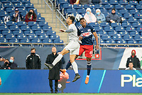 FOXBOROUGH, MA - APRIL 17: Stanley Alves #21 of Richmond Kickers and Francois Dulysse #60 of New England Revolution II compete for a high ball during a game between Richmond Kickers and Revolution II at Gillette Stadium on April 17, 2021 in Foxborough, Massachusetts.