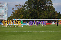 The Teams and spectators fall silent in respect of the events of 11th September 2001 ahead of Sutton United vs Stevenage, Sky Bet EFL League 2 Football at the VBS Community Stadium on 11th September 2021
