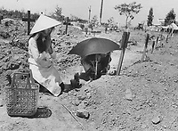 1973 FILE PHOTO -<br /> <br /> Relatives of a dead South Vietnamese soldier grieve at his graveside in the military cemetery at Ben Hoa. Death also came to an estimated 325;000 South Vietnamese civilians. For many living in misery; it was a blessing.