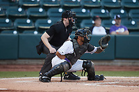 Winston-Salem Dash catcher Kleyder Sanchez (18) sets a target as home plate umpire Mitch Leikam looks on during the game against the Hickory Crawdads at Truist Stadium on July 10, 2021 in Winston-Salem, North Carolina. (Brian Westerholt/Four Seam Images)