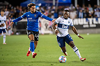 SAN JOSE, CA - AUGUST 13: Cade Cowell #44 of the San Jose Earthquakes challenges Cristian Daaome #11 of the Vancouver Whitecaps during a game between San Jose Earthquakes and Vancouver Whitecaps at PayPal Park on August 13, 2021 in San Jose, California.