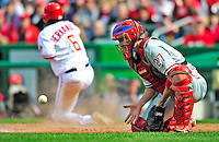 13 April 2009: Philadelphia Phillies' catcher Chris Coste receives a late throw in the second inning as Anderson Hernandez scores during the Washington Nationals' Home Opener at Nationals Park in Washington, DC. The Nats fell short in their 9th inning rally, losing 9-8, as the visiting Phillies handed the Nats their 7th consecutive loss of the 2009 season. Mandatory Credit: Ed Wolfstein Photo