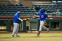 AZL Cubs left fielder Nelson Velazquez (20) is congratulated by third base coach Ben Carhart after hitting a ninth inning home run against the AZL Giants on September 5, 2017 at Scottsdale Stadium in Scottsdale, Arizona. AZL Cubs defeated the AZL Giants 10-4 to take a 1-0 lead in the Arizona League Championship Series. (Zachary Lucy/Four Seam Images)