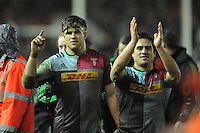 Jack Clifford and Ben Botica of Harlequins celebrate beating the table leaders during the Premiership Rugby match between Harlequins and Saracens - 09/01/2016 - Twickenham Stoop, London<br /> Mandatory Credit: Rob Munro/Stewart Communications