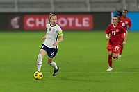 ORLANDO CITY, FL - FEBRUARY 18: Becky Sauerbrunn #4 looks for options with the ball during a game between Canada and USWNT at Exploria stadium on February 18, 2021 in Orlando City, Florida.