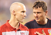 Bob Bradley head coach of the USA yalks to Lubos Kubik during an international friendly match against Brazil in Giants Stadium, on August 10 2010, in East Rutherford, New Jersey.Brazil won 2-0.