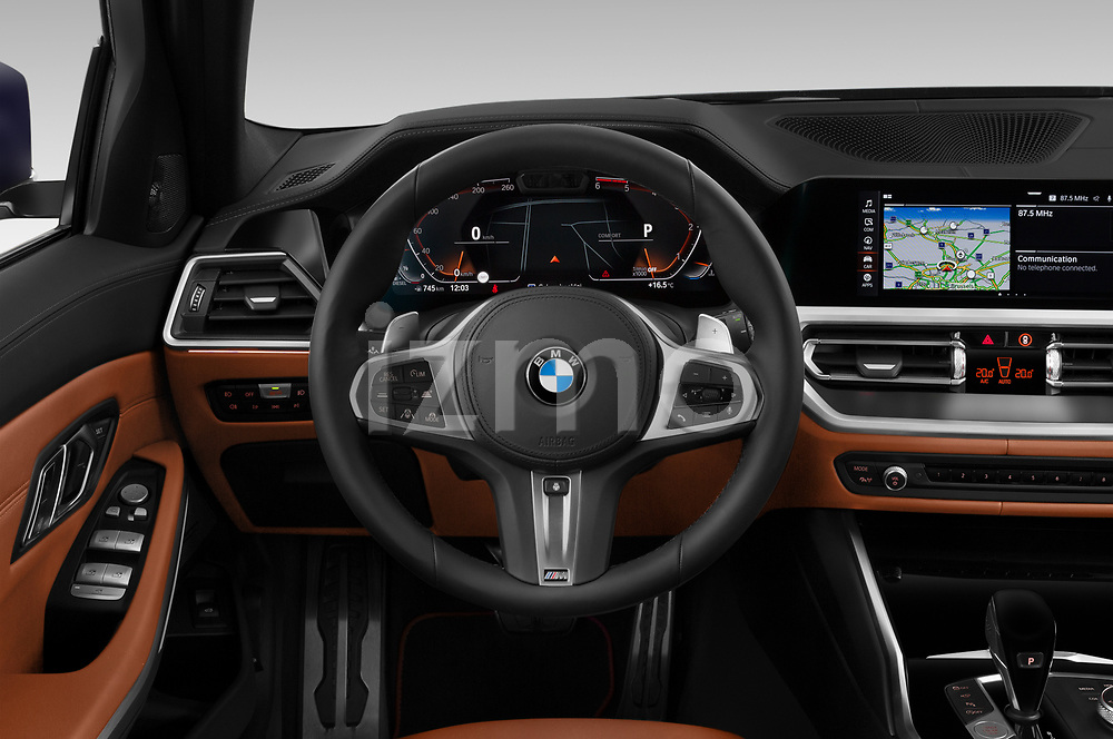 Car pictures of steering wheel view of a 2020 BMW 3-Series M-Sport 5 Door Wagon Steering Wheel