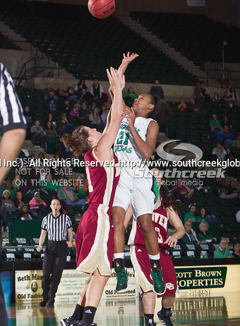 Denver Pioneer Women guard Jordan Johnston (11) in action during the game between the Denver Pioneer Women and the University of North Texas Mean Green at the North Texas Coliseum,the Super Pit, in Denton, Texas. Denver defeats UNT 50 to 44...