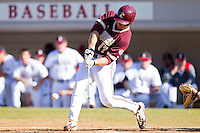 Matt Leeds #17 of the College of Charleston Cougars makes contact with the baseball against the Davidson Wildcats at Wilson Field on March 12, 2011 in Davidson, North Carolina.  The Wildcats defeated the Cougars 8-3.  Photo by Brian Westerholt / Four Seam Images