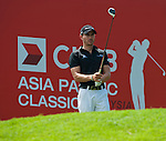 Camilo Villegas tees off at the sixth hole during Round 2 of the CIMB Asia Pacific Classic 2011.  Photo © Andy Jones / PSI for Carbon Worldwide