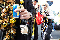 """Thousands of Saints fans wearing dresses paraded from the Louisiana Superdome to the French Quarter on January 31, 2010 in New Orleans to honor a promise made by the late sportscaster and Saints super-fan Buddy Diliberto aka """"Buddy D"""".<br /> <br /> In 1993 Buddy D, who passed away in 2005, remarked on air that if the Saints were to make it to the Super Bowl, he would wear a dress and dance down the streets.  The comment was repeated at various times and never forgotten by his listeners.<br /> <br /> Led by former New Orleans Saints quarterback Bobby Hebert, who has taken Buddy D's place on WWL radio, thousands made good on his promise for him, dancing, drinking, and cavorting their way down the street, alternately yelling out """"Who Dat!"""" and """"Buddy D!"""" in front of an onlooking crowd an estimated 85,000 people strong.<br /> <br /> The hard luck NFL team the New Orleans Saints has reached its first Super Bowl in team history, after 43 years largely filled with losing seasons and futility.  It is difficult to travel anywhere in the area without some reminder of this fact, as the team and city are intertwined perhaps like no other sports franchise in this country."""