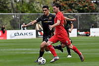 Garbhan Coughlan of Canterbury United competes for the ball with Ben Mata of Team Wellington during the ISPS Handa Men's Premiership - Team Wellington v Canterbury Utd at David Farrington Park, Wellington on Saturday 19 December 2020.<br /> Copyright photo: Masanori Udagawa /  www.photosport.nz