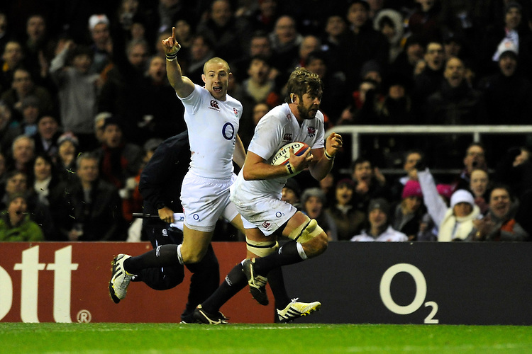 Geoff Parling of England runs in a try as team mate Mike Brown of England cheers him on during the RBS 6 Nations match between England and Scotland at Twickenham on Saturday 02 February 2013 (Photo by Rob Munro)