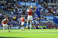 Shkodran Mustafi of Arsenal vies for possession with Danny Ward of Cardiff City during the Premier League match between Cardiff City and Arsenal at Cardiff City Stadium in Cardiff, Wales, UK. September 2, 2018