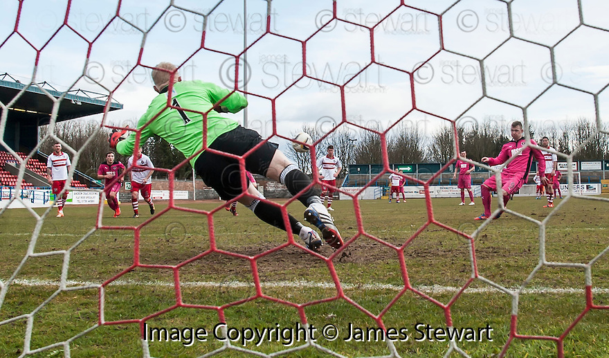 Airdrie's Bryan Prunty scores their first goal from the spot.