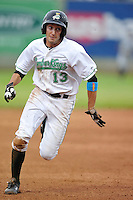 Aaron Barbosa #13 of the Clinton LumberKings runs to third base against the West Michigan Whitecaps at Ashford University Field on July  25, 2014 in Clinton, Iowa. The Whitecaps won 9-0.   (Dennis Hubbard/Four Seam Images)
