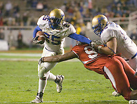 23 December 2006: Tulsa running back Tarrion Adams (#25) breaks a tackle during the 2006 Bell Helicopters Armed Forces Bowl between The University of Tulsa and The University of Utah at Amon G. Carter Stadium in Fort Worth, TX.