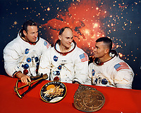 The original Apollo 13 crew - Jim Lovell (left), Ken Mattingly, and Fred Haise - pose for a crew portrait. Note that Lovell does not have a distinguishing stripe on his arm at this time. December 1969
