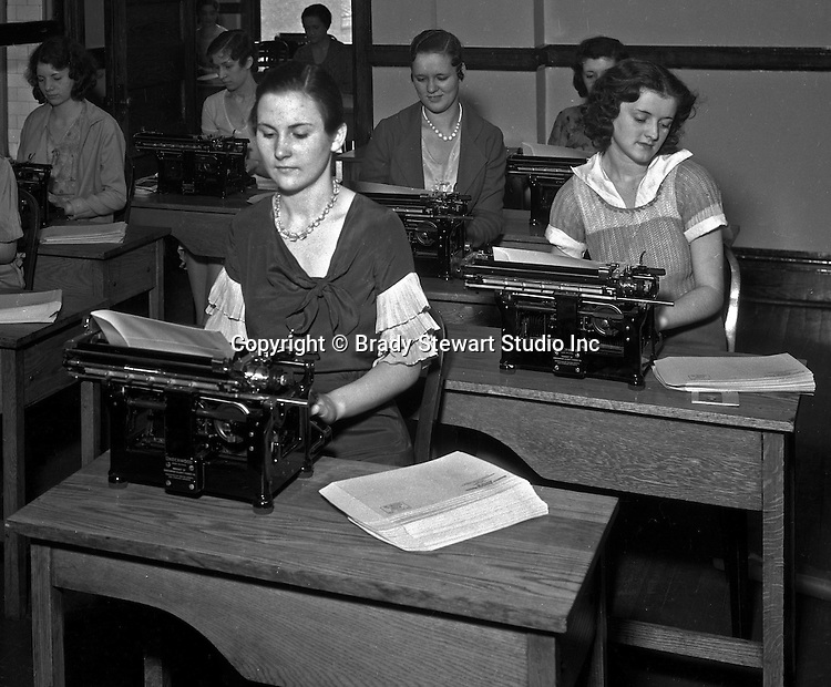 Pittsburgh PA: Young women working hard in Duquesne University's typing class.