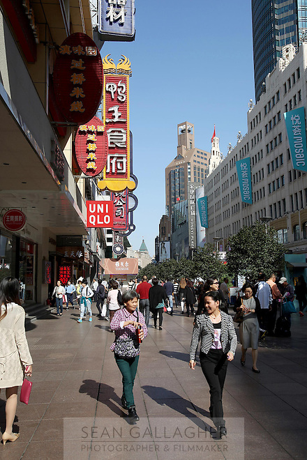 Shoppers mingling along the Nanjing Road shopping district. <br />