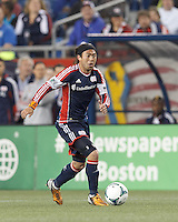 New England Revolution midfielder Lee Nguyen (24) brings the ball forward.  In a Major League Soccer (MLS) match, Real Salt Lake (white)defeated the New England Revolution (blue), 2-1, at Gillette Stadium on May 8, 2013.